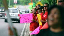 Communications Workers of America members protest outside the Dallas Arboretum in Dallas where AT&T was holding its annual meeting of stockholders in this 2009 file photo.