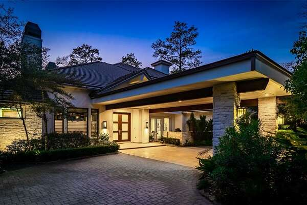 Located at 27 Maymont Way in The Woodlands, this $2.4 million home offers five to six bedrooms, six full and one half bathrooms, game room, wine cellar, outdoor lanai with summer kitchen and an elevator.