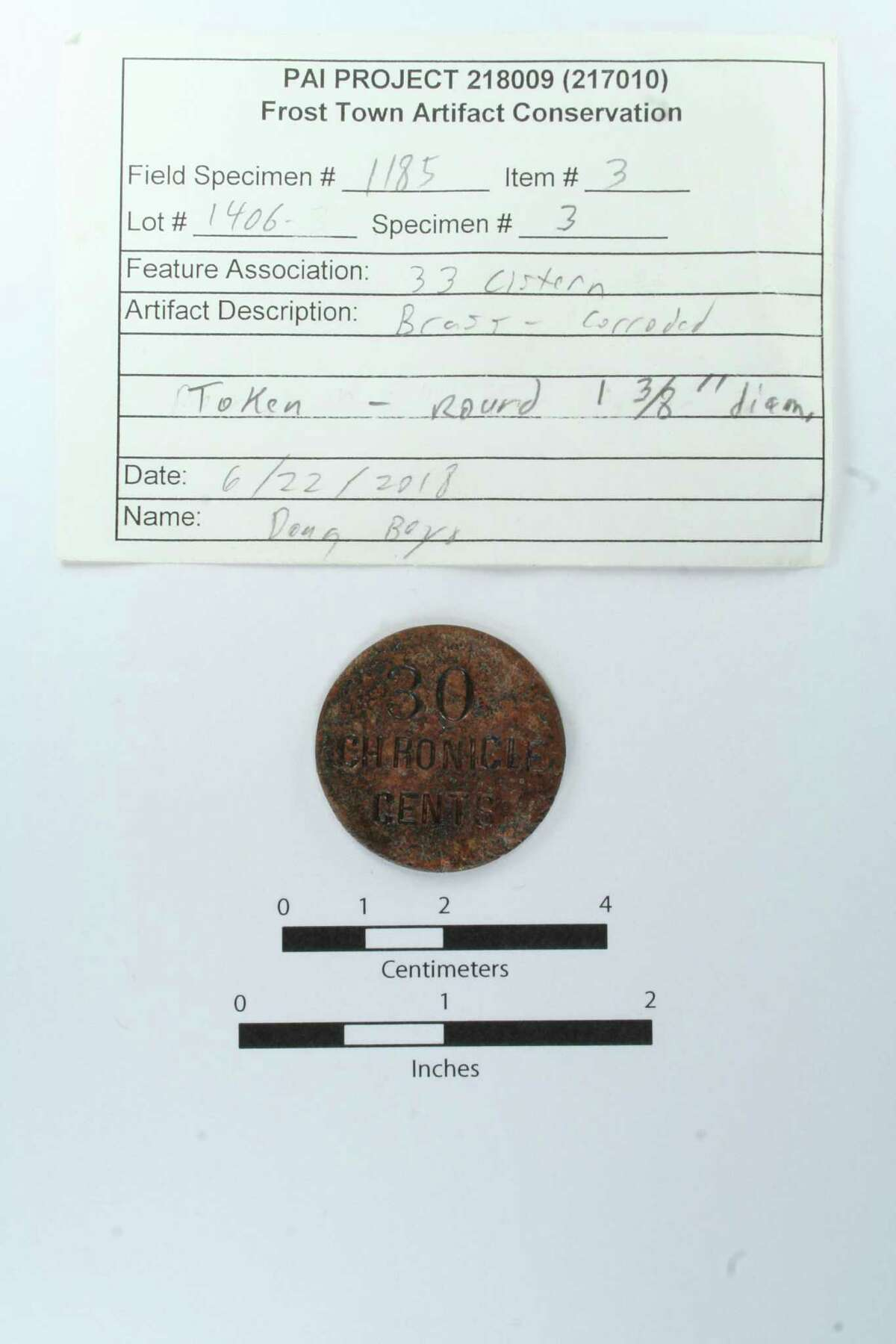 """Local archaeologists found this mystery """"Houston Chronicle"""" coin in Houston. But what is it?"""