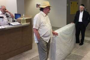 Union activists Victor Batorski and Usher Piller delivered a mattress to OCFS as part of a publicity stunt in 2017.