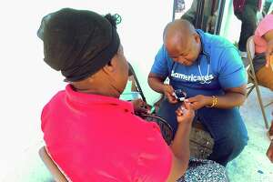 An Americares health care professional provides a consultation to a resident in Marsh Harbor in the Bahamas. Americares has announced that it plans to provide about 3,500 free patient consultations from February 2020 through June 2020.