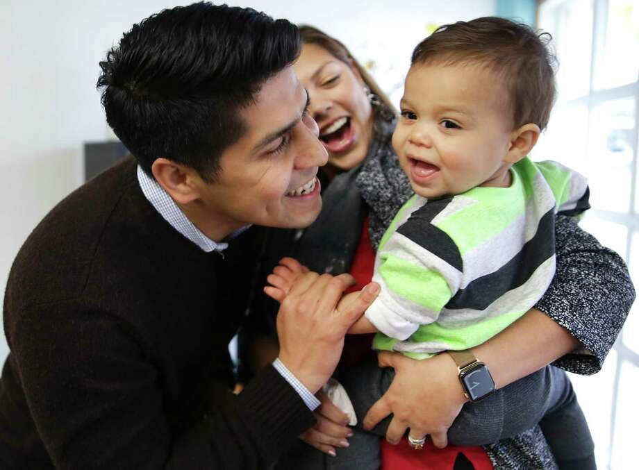 Saldaña and his wife, Jessica Flynn Saldaña, pick up their 16-month-old son, Eli, from Mustard Seed Academy. Saldaña will be leaving San Antonio to lead a national education nonprofit called Communities in Schools, based in Arlington, Va. Photo: Bob Owen /San Antonio Express-News / San Antonio Express-News