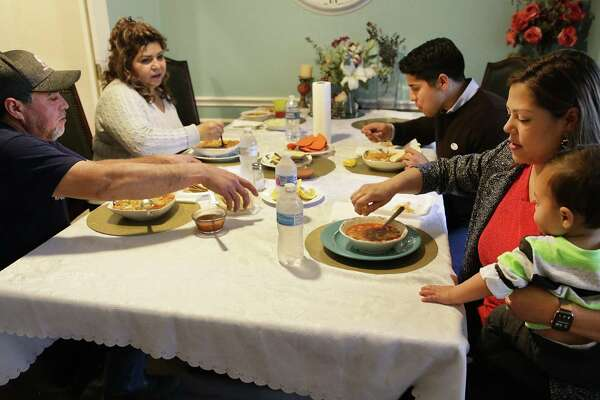 Rey Saldaña, back right, has a pozole dinner made by his mother, Maricela Saldaña, back left, with his father, Reynold Saldaña, wife, Jessica Flynn Saldaña, and son Eli.