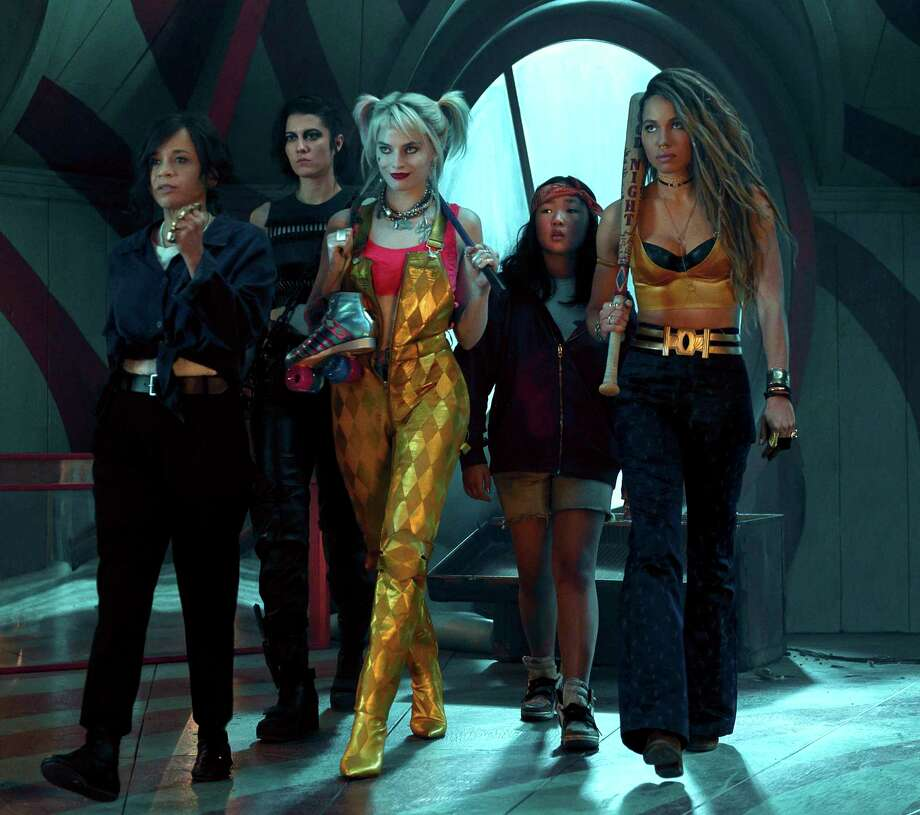 """This image released by Warner Bros. Pictures shows, from left, Rosie Perez, Mary Elizabeth Winstead, Margot Robbie, Ella Jay Basco and Jurnee Smollett-Bell in a scene from """"Birds of Prey."""" (Claudette Barius/Warner Bros. Pictures via AP) Photo: Claudette Barius / Associated Press / © 2019 Warner Bros. Entertainment Inc. All Rights Reserved."""