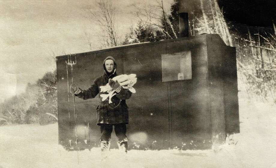 Dr. Forrest McLain after a very successful day pike spearing on Long Lake, 1915. (Courtesy photo)