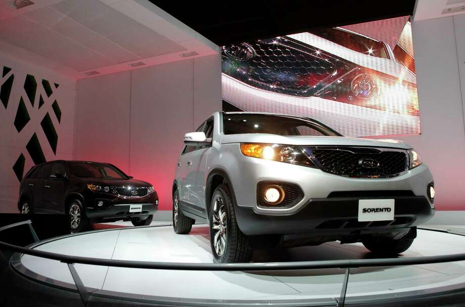Kia is joining its affiliate Hyundai in recalling thousands of vehicles in the U.S. because water can get into a brake computer, cause an electrical short and possibly a fire. The Kia recall covers nearly 229,000 Sedona minivans from the 2006 through 2010 model years. Also covered are Sorento SUVs from 2007 through 2009. (AP Photo/Jae C. Hong, File) / AP2009