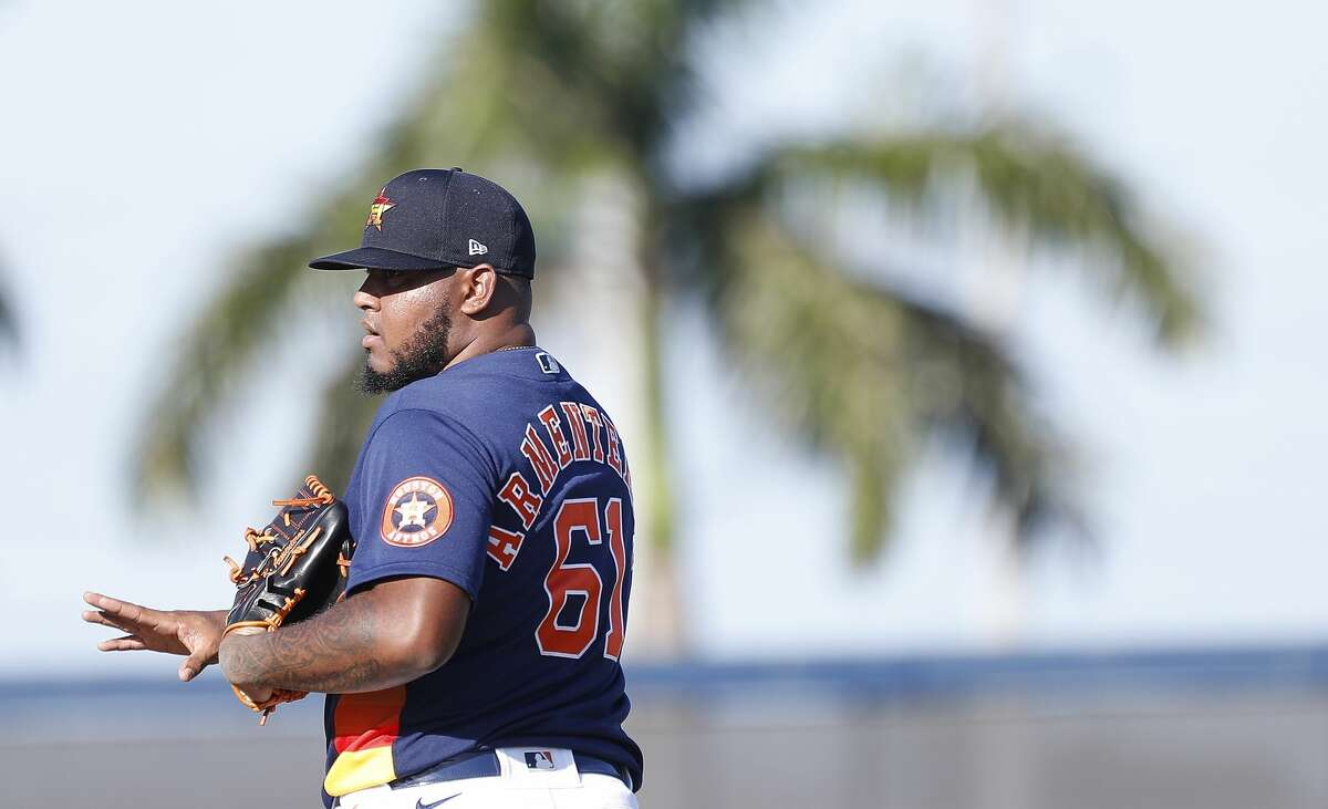 Houston Astros pitcher Rogelio Armenteros (61) throws a quick live bullpen session during the first full-squad Houston Astros spring training workout at the Fitteam Ballpark of The Palm Beaches, in West Palm Beach , Monday, Feb. 17, 2020.
