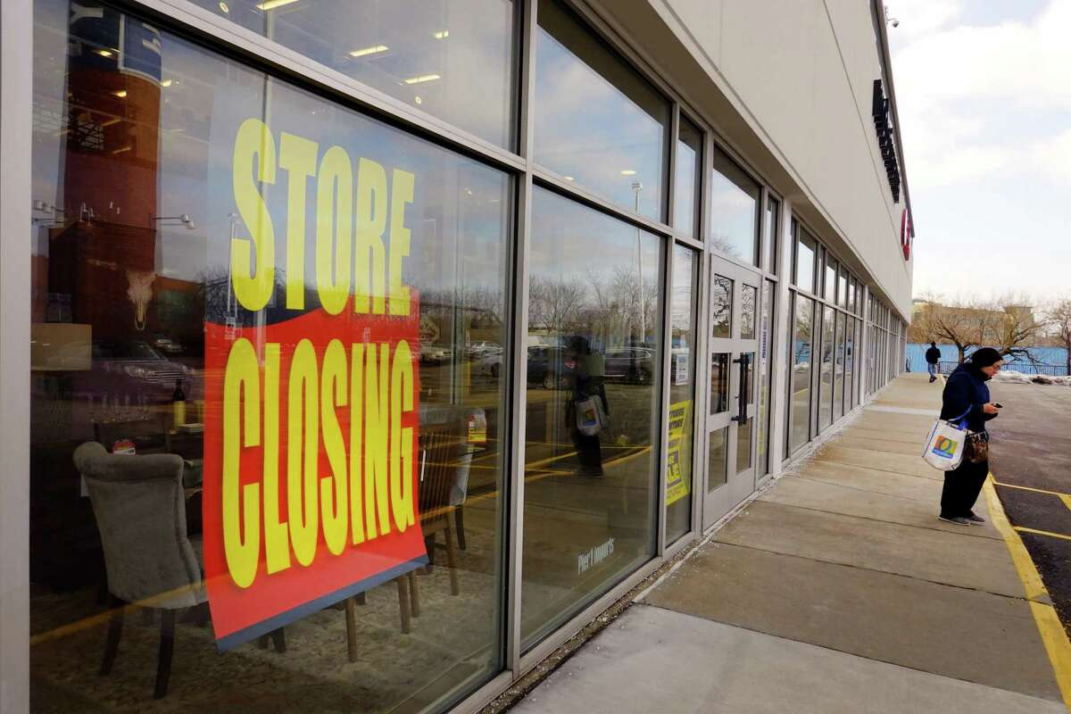 Store closing signs hang in the window of a Pier 1 imports store in Chicago, Illinois. The retailer filed for bankruptcy protection this week.