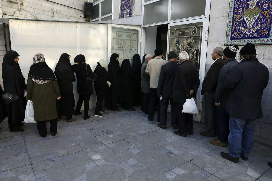 "Voters line up in Tehran to cast their ballots in Iran's parliamentary election. U.S. Secretary of State Mike Pompeo criticized the election as a ""sham."" Photo: Vahid Salemi / Associated Press"