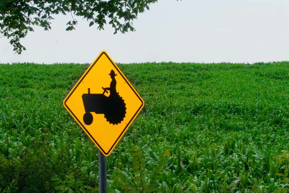 Albany Times Union Staff Photo--Michael P. Farrell--A tractor crossing sign at a corn field on route 30A in Fultonville, New York July 21, 2006.