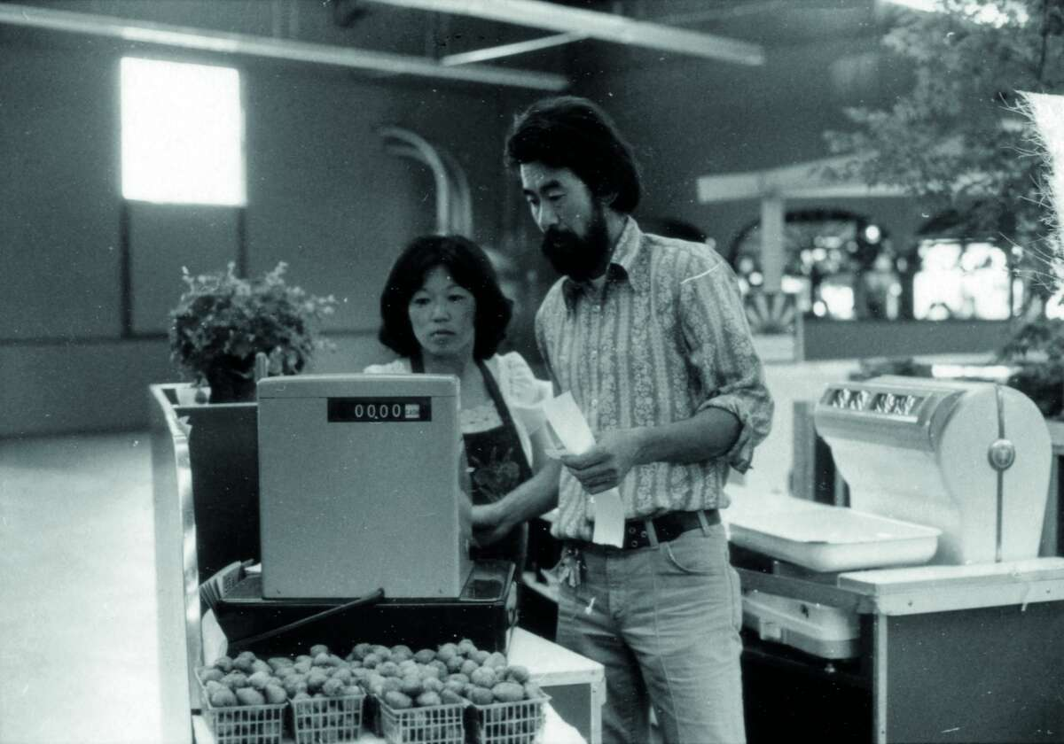 Diane Yasuda (left) and Glenn Yasuda operate a cash register in their original Berkeley Bowl store in 1977.