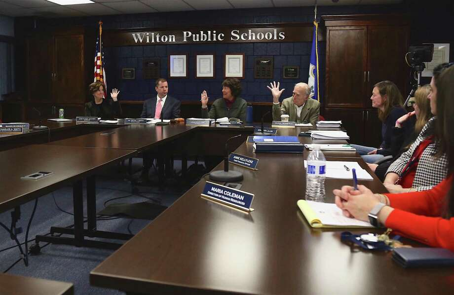 It was unanimous as Board of Education members vote to adopt the superintendent's proposed $84-million budget Thursday night. Photo: Jarret Liotta / Hearst Connecticut Media / Wilton Bulletin