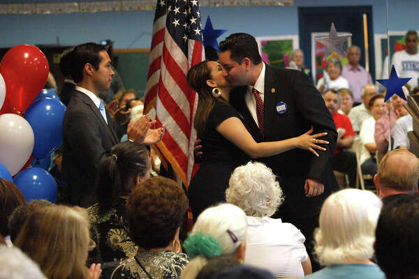City Councilman Phlip Cortez gets a hug from his girlfriend Leticia Cantu following the announcement of his bid for re-election to San Antonio District Council District 4 at Jean Yates Community Center at Rainbow Hills Park on Sunday March 8, 2009. Mayoral candidate Julian Castro applauds at left.