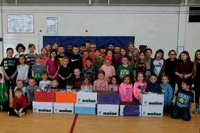 Pictured are students from Smith and O'Hara-Langar's kindergarten classes. The two classes collected nearly 200 bottles of shampoo for Our Brother's Keeper. (Courtesy photo)