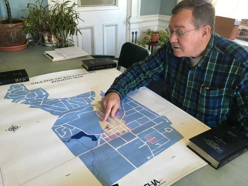 Ballston Spa Mayor Larry Woolbright points to the area of Ballston Spa's central business district in his office in Village Hall.