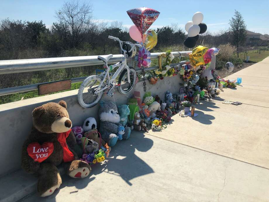 The community left stuffed animals, notes and flowers to honor Irie Suarez, a 10-year-old fifth-grade girl from Kallison Elementary who was fatally struck by a car while riding her bike to school Thursday. Photo: Krista Torralva