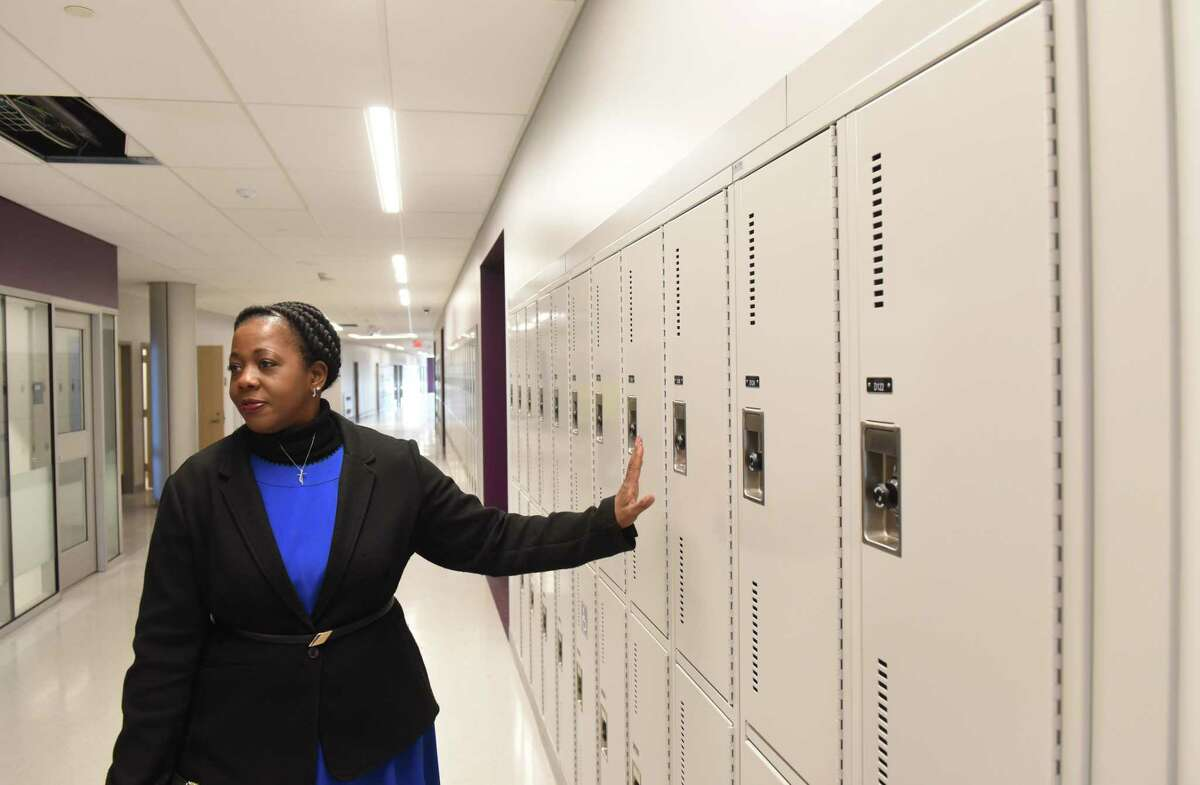 Albany School District Superintendent Kaweeda Adams shows improved school lockers inside the new Albany High School expansion on Friday, Feb. 21, 2020, in Albany, N.Y. The improvements are part of the first phase of the district?•s $180 million renovation and expansion of the school. (Will Waldron/Times Union)