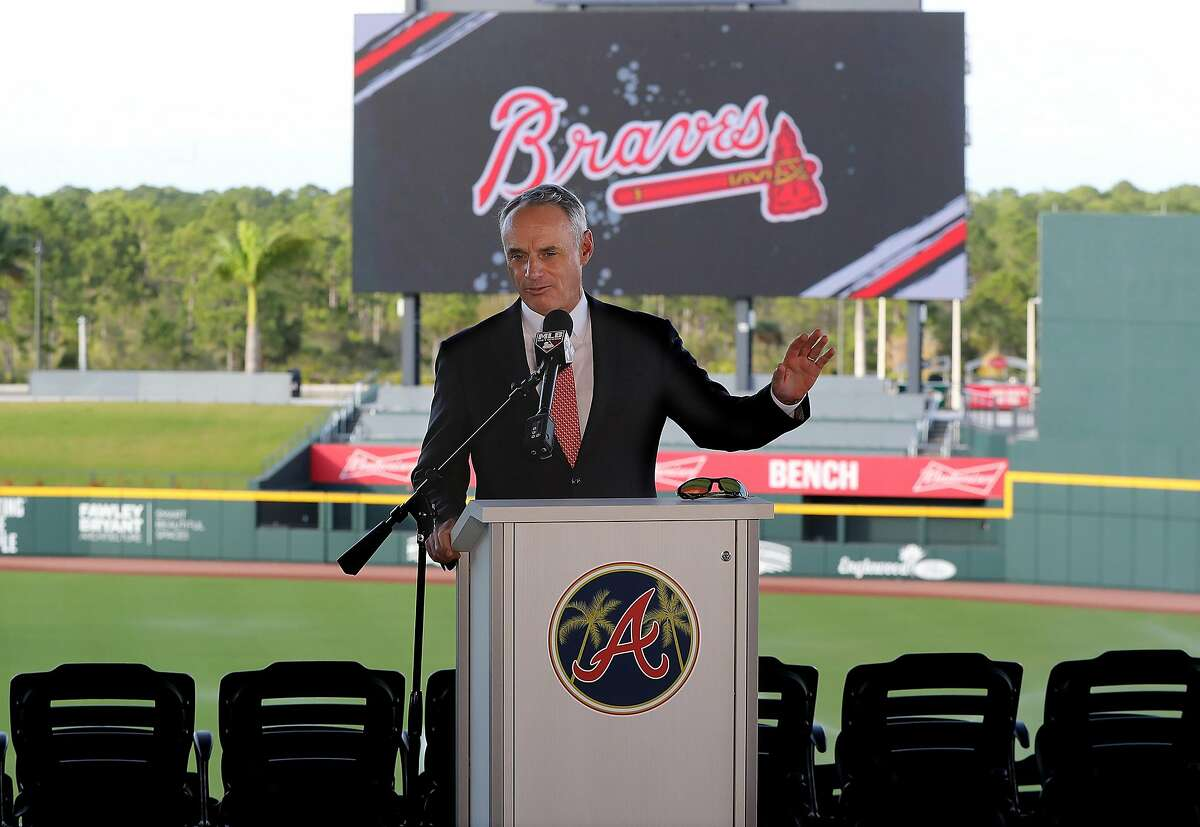 """Major League Baseball Commissioner Rob Manfred takes questions about the Houston Astros while holding his press conference during the """"Florida Governor's Dinner"""" kicking off spring training at the Atlanta Braves CoolToday Park on Sunday, Feb. 16, 2020, in North Port, Fla. (Curtis Compton/Atlanta Journal-Constitution/TNS)"""