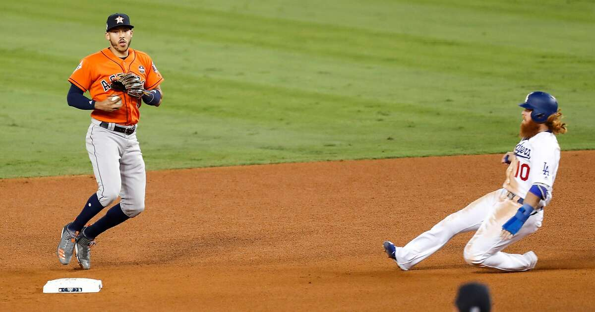 Houston Astros shortstop Carlos Correa (1) forces out Los Angeles Dodgers third baseman Justin Turner (10) on a fielders choice during the fifth inning of Game 7 of the World Series at Dodger Stadium on Wednesday, Nov. 1, 2017, in Los Angeles. ( Brett Coomer / Houston Chronicle )