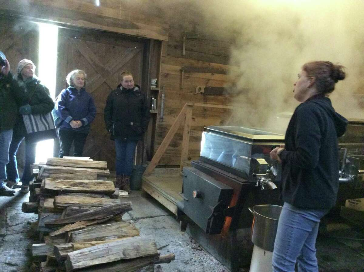 In the sugarhouse, vats of sap are heated to evaporate off water and leave delicious maple syrup.