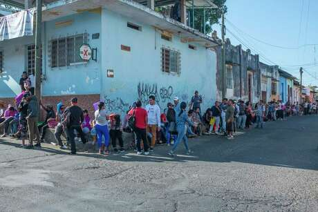 Thousands of migrants returned to southern Mexico, and now seek visas to work while waiting to return to the north. Here migrants line up outside the offices of COMAR (Comisión Mexicana de Ayuda a Refugiados) in Tapachula.