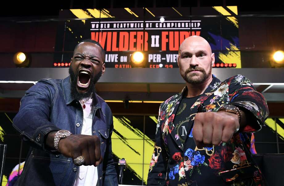 LOS ANGELES, CA - JANUARY 25: Deontay Wilder (L) and Tyson Fury face off during a news conference at Fox Studios on January 25, 2020 in Los Angeles, California. (Photo by Kevork Djansezian/Getty Images) Photo: Getty Images / 2020 Getty Images