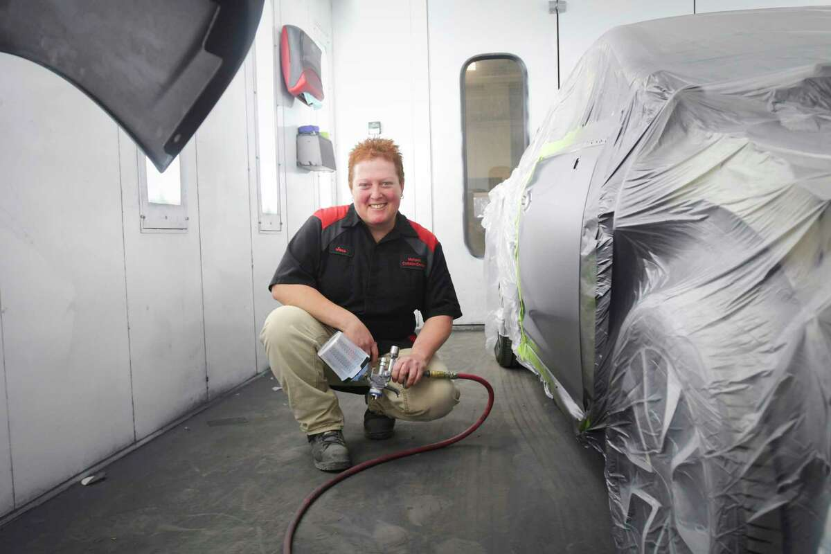 Jessica Rava, a collision refinish technician at Mohawk Collision Center, poses for a photo inside a spray booth at the business on Tuesday, Jan. 14, 2020, in Schenectady, N.Y. (Paul Buckowski/Times Union)