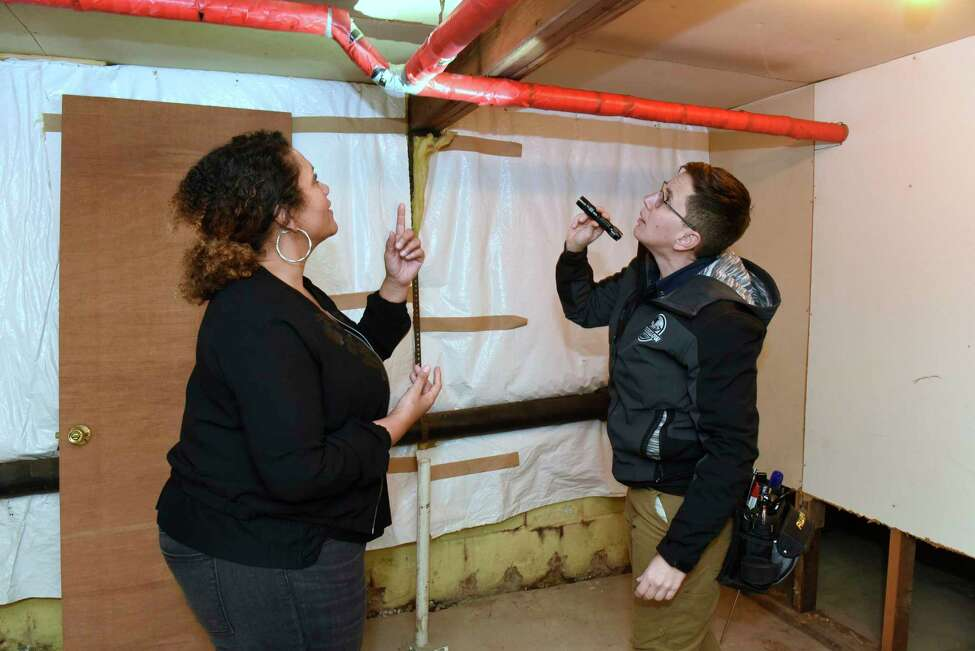Alyssa Hackett of Wolf Hollow Home Inspections, right, stands in the basement where she's doing a consult for customer Jessica Pelton, left, on Friday, Jan. 17, 2020 in Niskayuna, N.Y. (Lori Van Buren/Times Union)