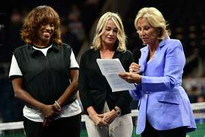 Olympic athletes Jackie Joyner-Kersee, left, and Nadia Comaneci listen as Donna de Varona reads the Aurora Games Athletes' Bill of Rights during Opening Ceremonies on opening night of the Aurora Games at the Times Union Center on Tuesday, Aug. 20, 2019 in Albany, N.Y. (Lori Van Buren/Times Union)