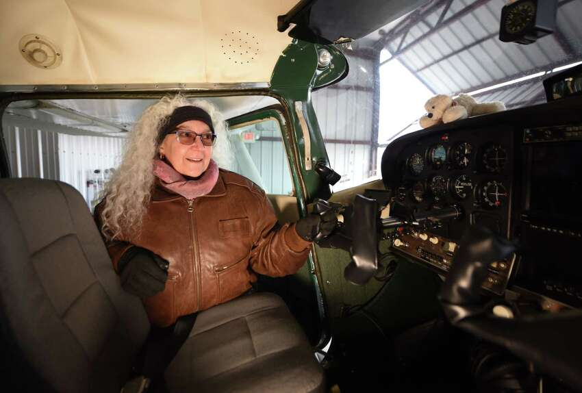 Linda Cioffi with her 1967 Cessna 182K on Friday, Jan. 10, 2020, in her hanger at Albany International Airport in Colonie, N.Y. Linda is a pilot and flight instructor, as well as the main contact for the Capital Region branch of the Ninety-Nines, an international flight group for women. (Will Waldron/Times Union)