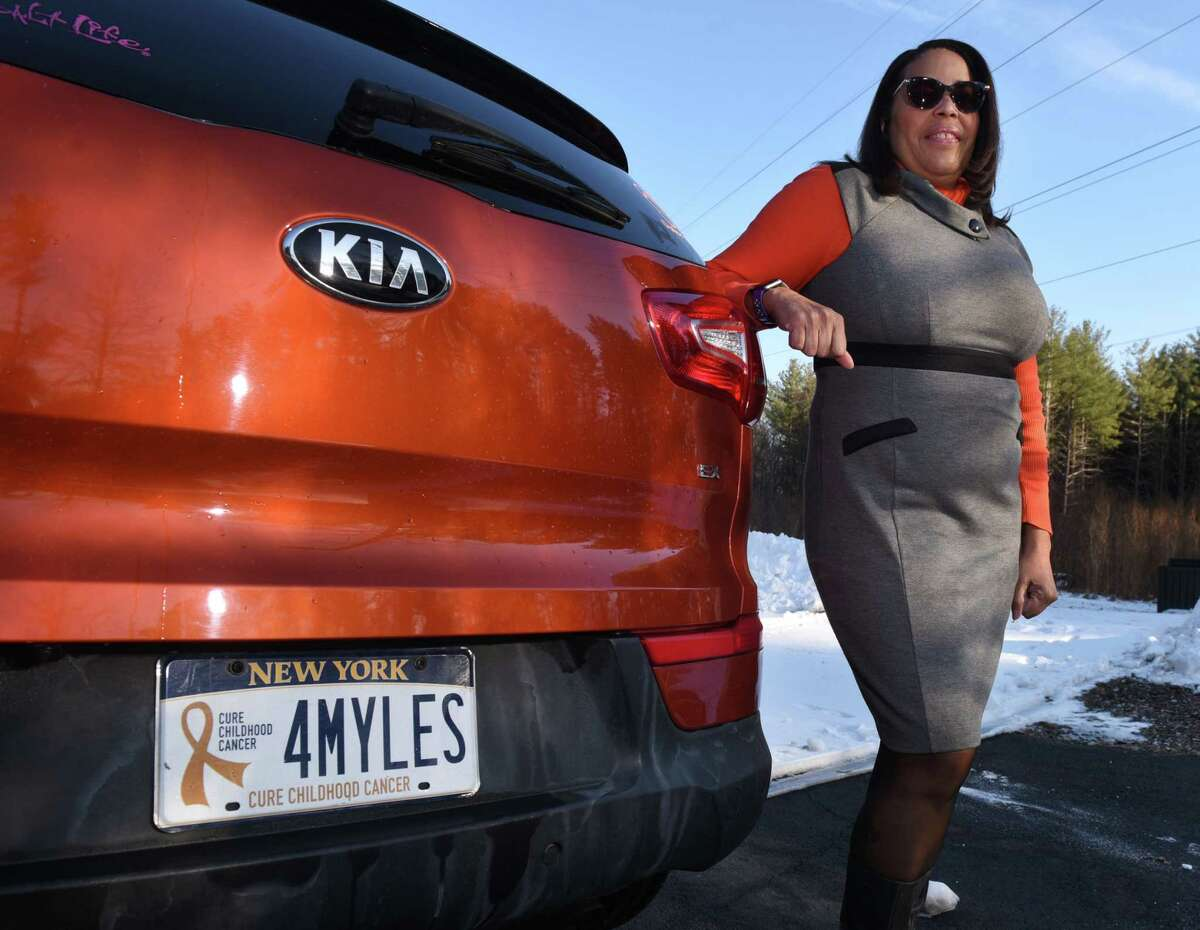 Laurel McAdoo is pictured next to her car on Wednesday, Jan. 22, 2020, in Bethlehem, N.Y. Laurel started Myles of Smiles after her son died of brain cancer in 2012. Orange was Myles's favorite color. (Will Waldron/Times Union)