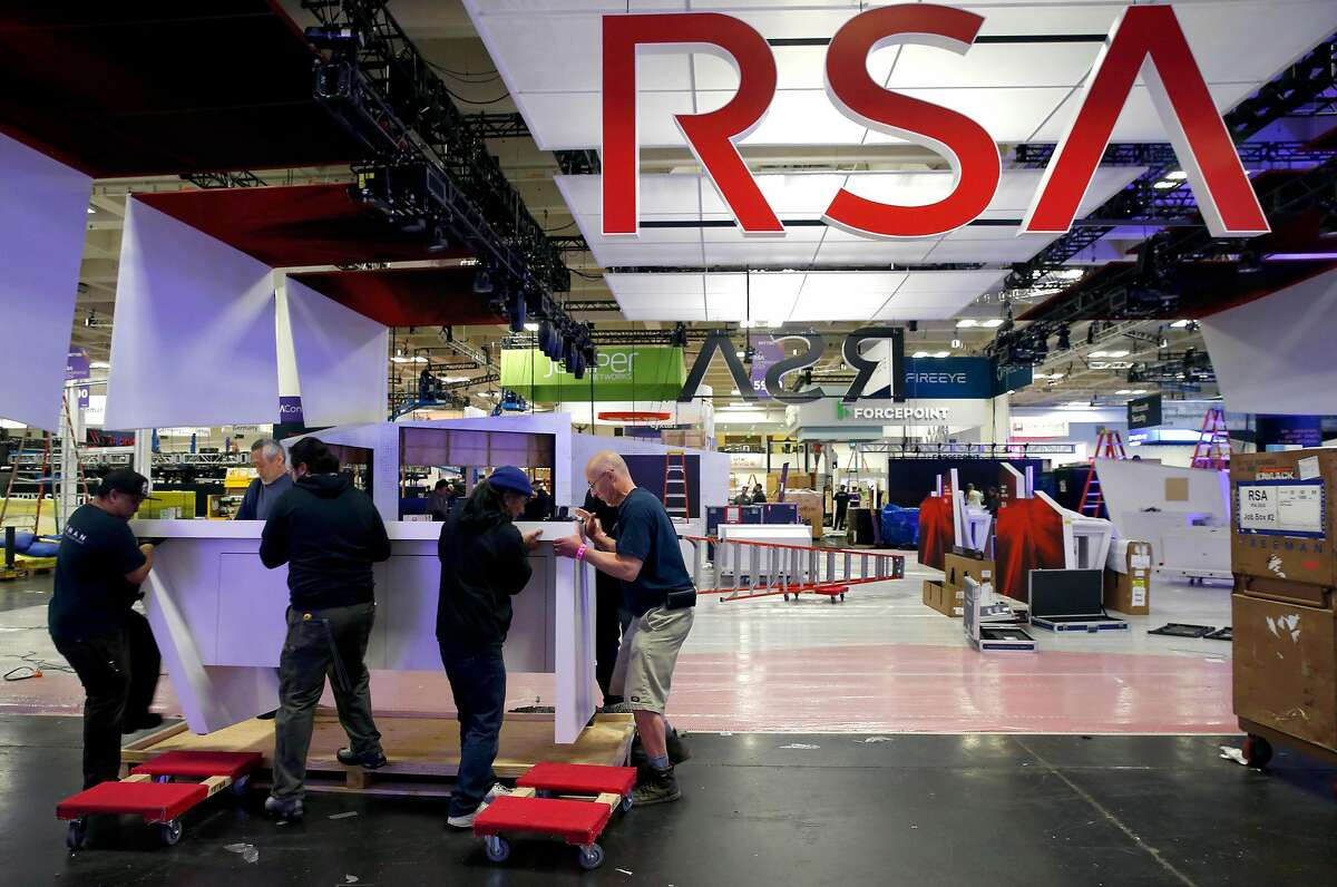 A construction crew assembles an exhibitor's display for the RSA Conference at Moscone Center in San Francisco, Calif. on Friday, March 1, 2019.