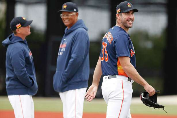 Houston Astros pitcher Justin Verlander (35) smiles as he walks back to the clubhouse, after deciding not to throw a bullpen session because of the rain during the Houston Astros spring training workouts at the Fitteam Ballpark of The Palm Beaches, in West Palm Beach, Friday, Feb. 21, 2020.