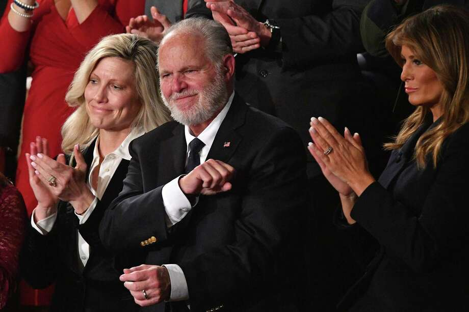 Radio personality Rush Limbaugh pumps his fist as he is acknowledged by President Donald Trump during the State of the Union address. Readers take issue with Trump's decision to award Limbaugh with the Presidential Medal of Freedom or praise for his radio work. Photo: MANDEL NGAN /AFP Via Getty Images / AFP