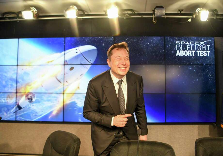 SpaceX CEO Elon Musk talks with reporters following a press conference after NASA and SpaceX's performed an in-flight abort test of the Crew Dragon capsule at NASA's Kennedy Space Center in Cape Canaveral, Fla., on Jan. 19, 2020. Photo: Washington Post Photo By Jonathan Newton / The Washington Post