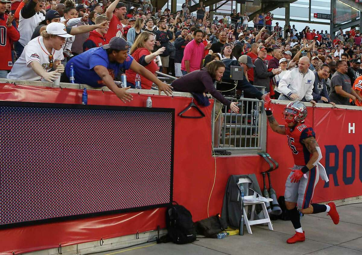Cody Brown high-fives Houston fans after his interception against St. Louis.