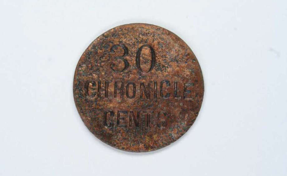 "Local archaeologists found this mystery ""Houston Chronicle"" coin in Houston. But what is it? Photo: Courtesy Photo"