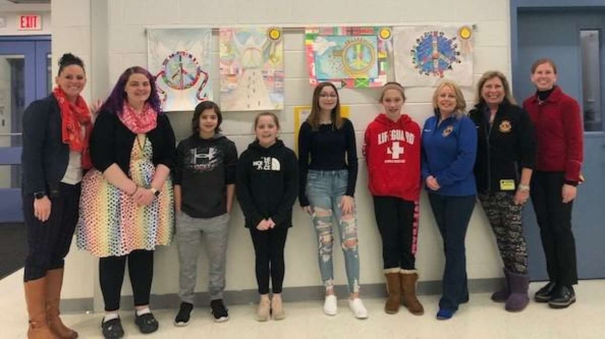 From left, Seymour Middle School Assistant Principal Kathleen Freimuth, Visual Arts Teacher Amanda Dingle, grand prize winner Michael Azzarone, 1st runner up Chloe Pernaselci, 2nd runner up Gianna Moramarco, 3rd runner up Jenna Smith, Seymour Lions Melissa A. Smith and Bettyann Peck, and SMS Principal Jodi Roden