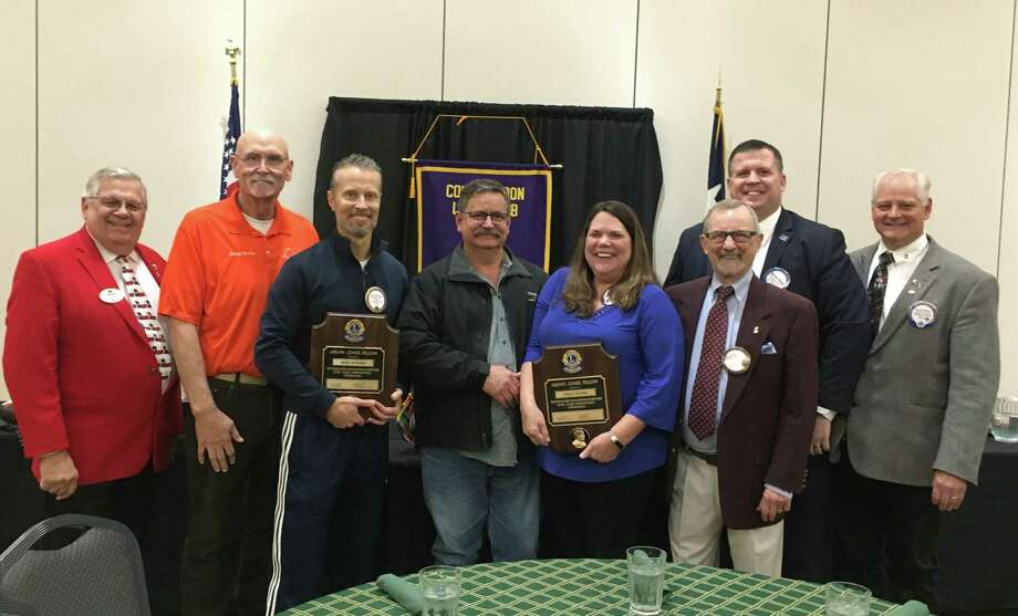 Lions Award High Honors - Conroe Noon Lions Club honored members Tracy Irvine, Warner Phelps and Mike Sproba with Lions Clubs International highest honor, the Melvin Jones Fellow Award at their club meeting last week. Pictured (l-r): District Governor Tony Austin, Greg Smith, Mike Sproba, Charlie Sproba, Tracy Sproba, Dick Giuffre, Warner Phelps, Club President Scott Perry. Photo: Courtesy Photo