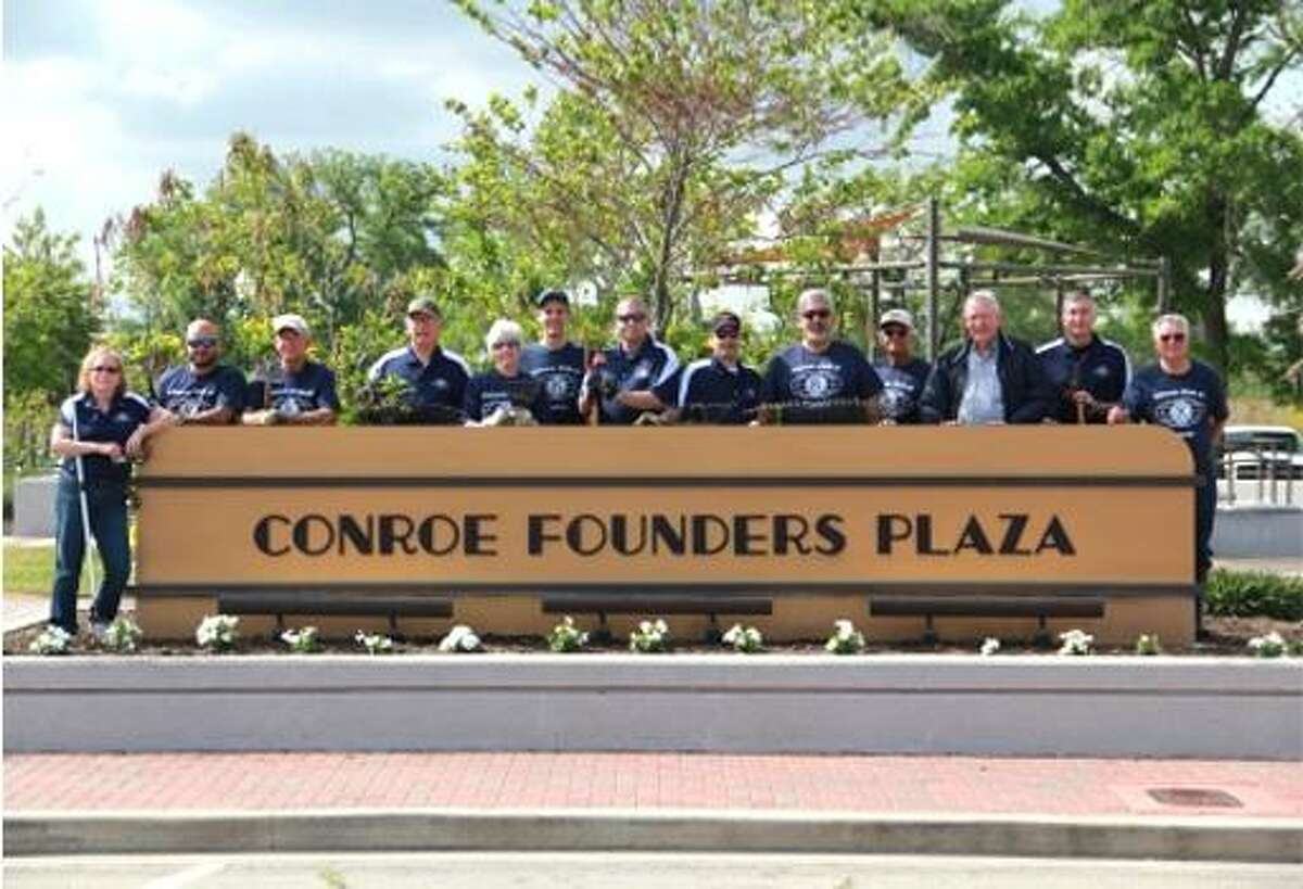 Members of the Conroe Noon Kiwanis Club at Founder's Plaza Park in downtown Conroe. The club has adopted the park.