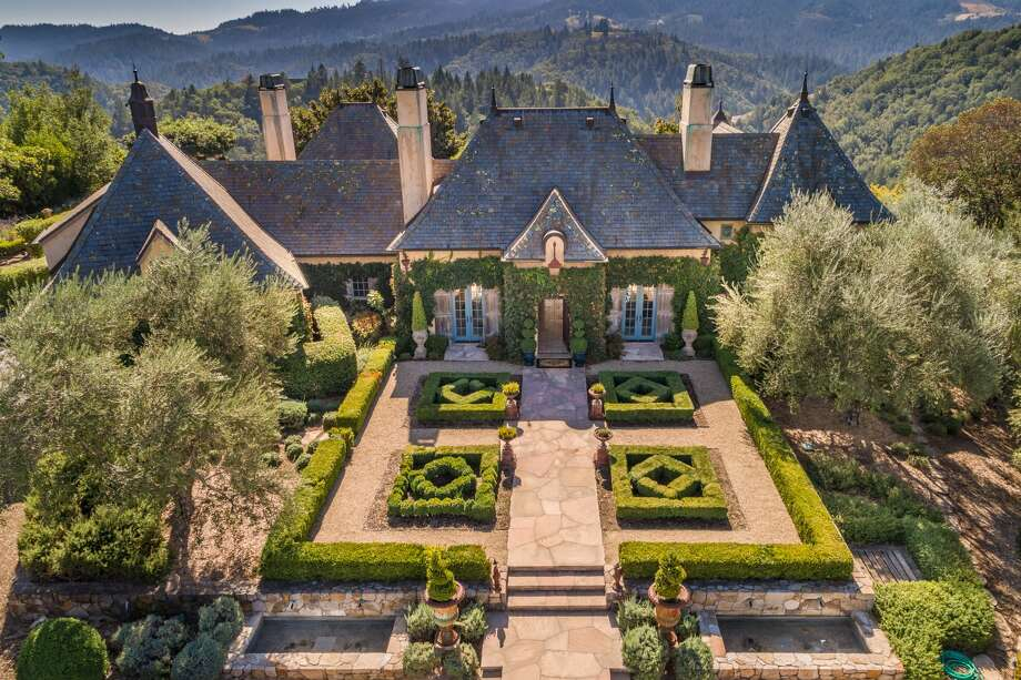 Amid rolling fields of grapevines, a grand Napa Valley estate at 100 Campbell Creek Rd. looks like it was plucked from the French countryside. The property sits on 47 acres and the main home features 4,600 square feet. Photo: Paul Rollins