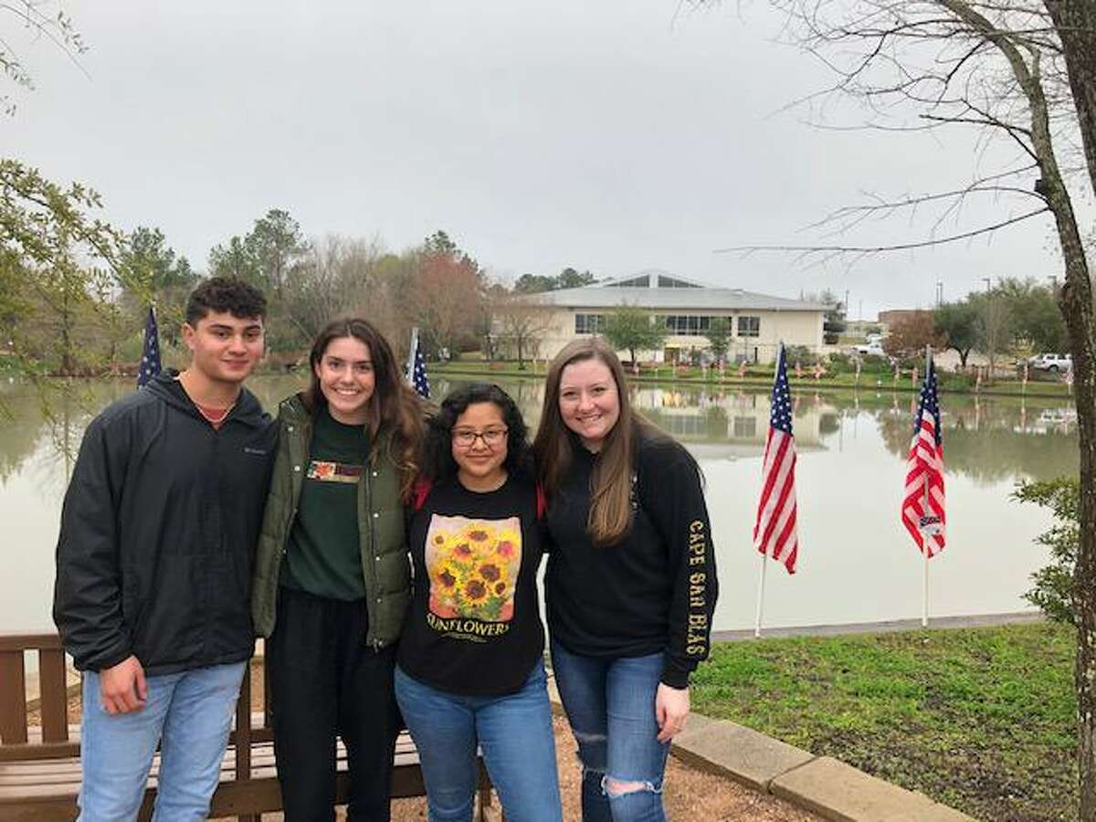 Interact Club students from Montgomery ISD recently place flags at Memory Park in Montgomery in advance of President's Day.