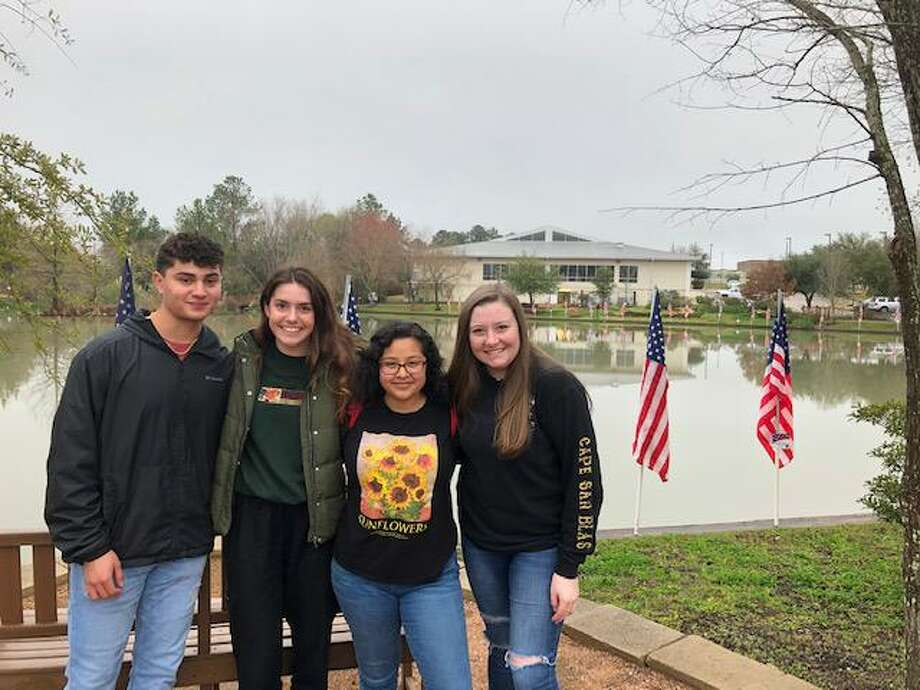 Interact Club students from Montgomery ISD recently place flags at Memory Park in Montgomery in advance of President's Day. Photo: Courtesy Photo