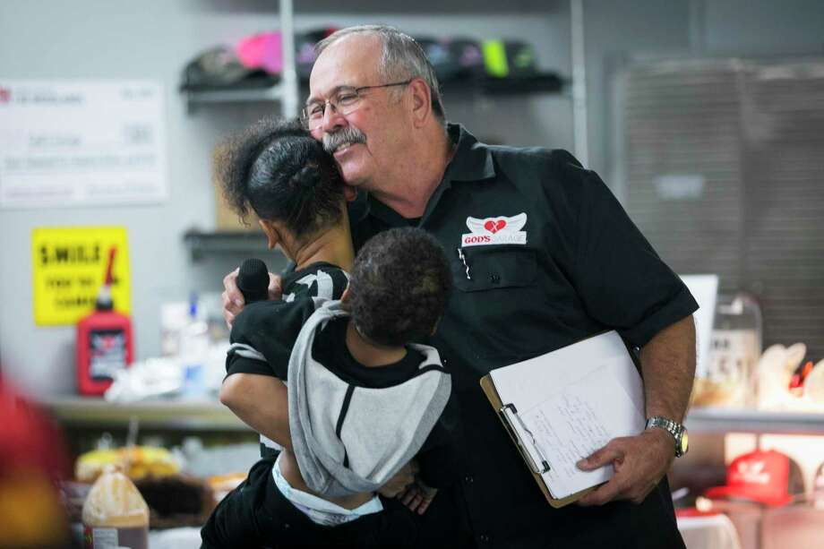 Timeka Gray hugs God's Garage president Harvey Yaw after receiving keys to a new vehicle during the God's Garage Christmas party and grand opening on Saturday, Dec. 7, 2019, in Conroe, TX. Photo: Annie Mulligan, Houston Chronicle / Contributor / © 2019 Annie Mulligan / Houston Chronicle