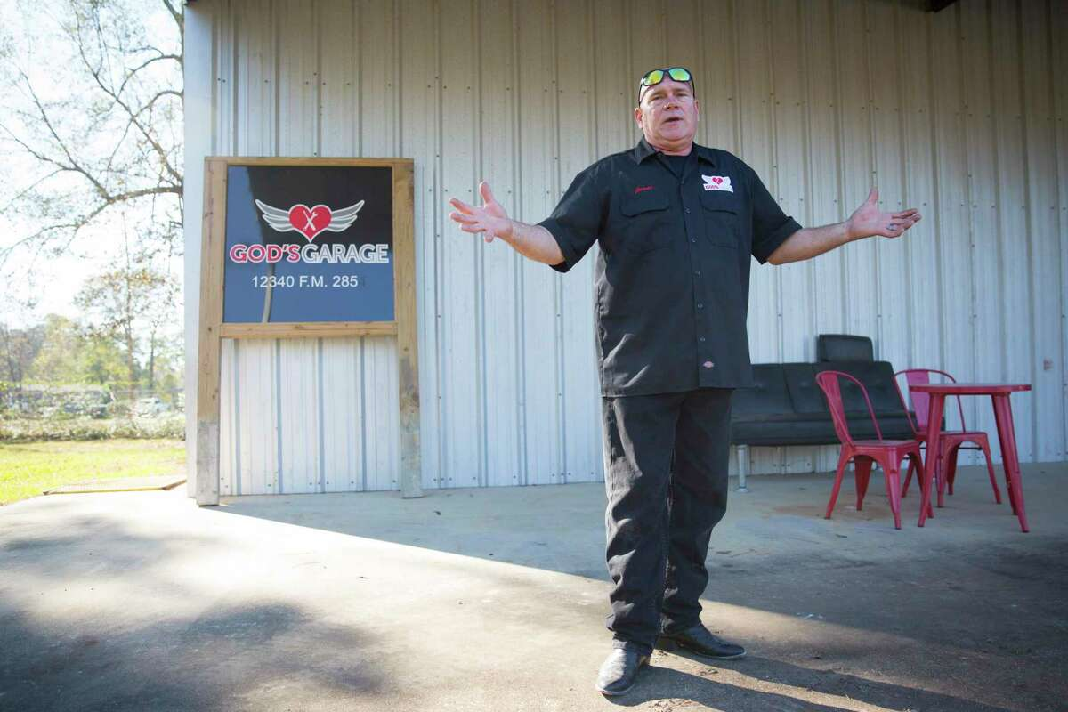 God's Garage shop operations manager James Minteer gives a tour of the new God's Garage location during the grand opening on Saturday, Dec. 7, 2019, in Conroe, TX. God's Garage provides cars to people in need after they participate in a series of life skills classes.