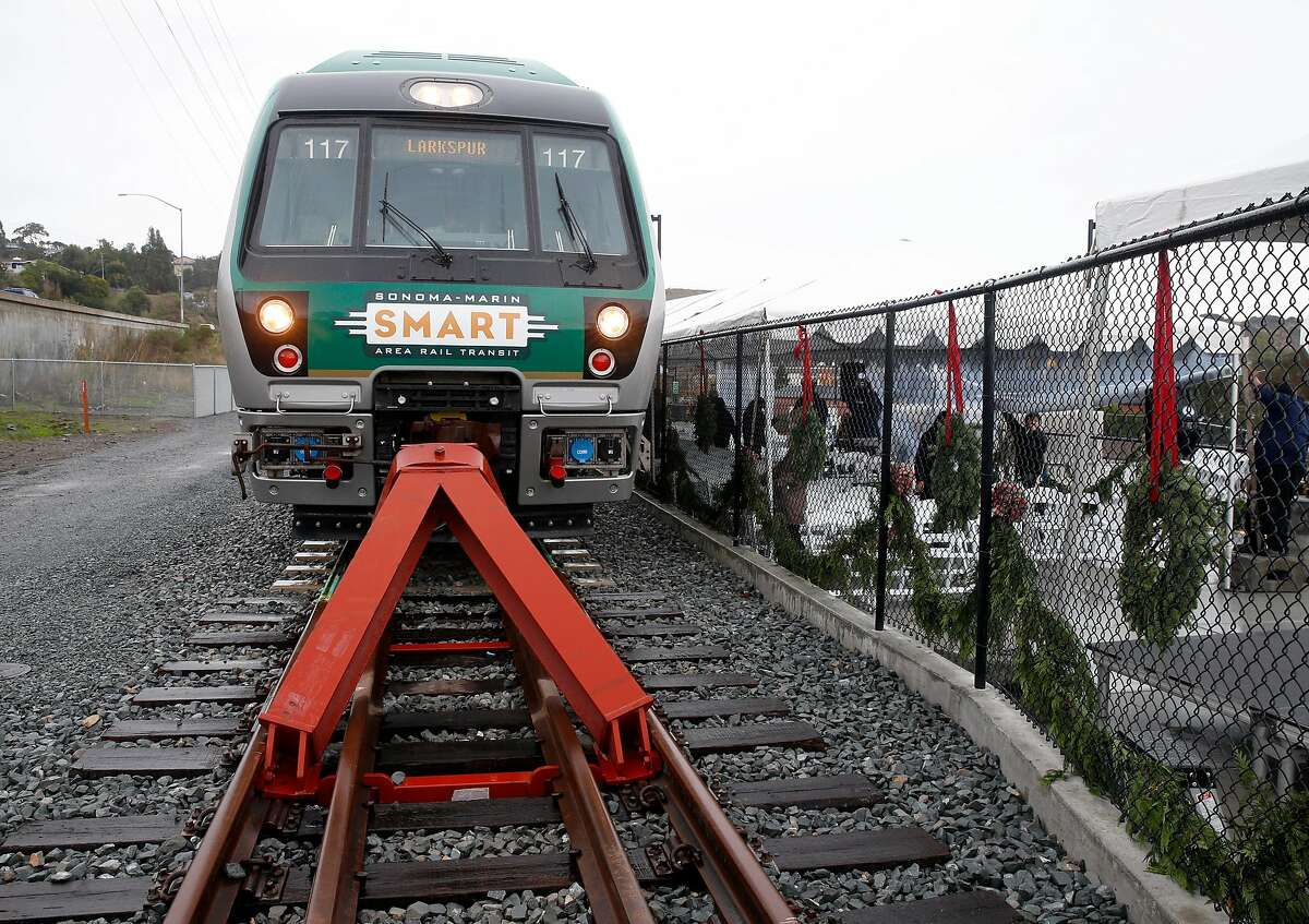 A SMART commuter train is parked at the new station in Larkspur, Calif. on Friday, Dec. 13, 2019. A five minute walk links commuters arriving at the southernmost station in the SMART train system to the Golden Gate Ferry terminal across the street.