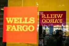 FILE -- A Wells Fargo bank branch in Manhattan, March 7, 2019. The bank is preparing to settle with federal prosecutors and the Securities and Exchange Commission over the widespread abuse of customers in its banking, auto lending and mortgage businesses, according to two people familiar with the matter. (Jeenah Moon/The New York Times)
