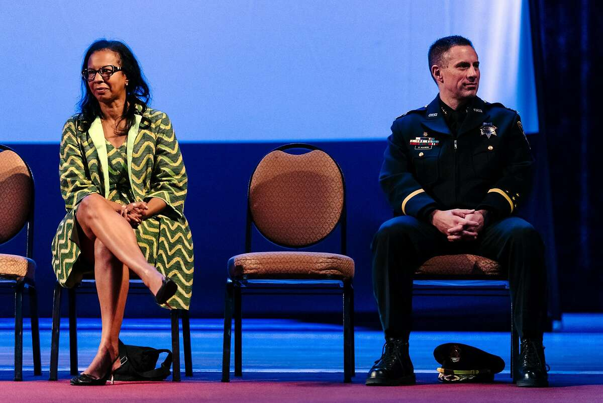 Acting Oakland Police Chief Darren Allison, right, and Oakland Police Commission chair Regina Jackson sit on stage during the Oakland Police Department's 183rd Basic Recruit Academy Graduation.
