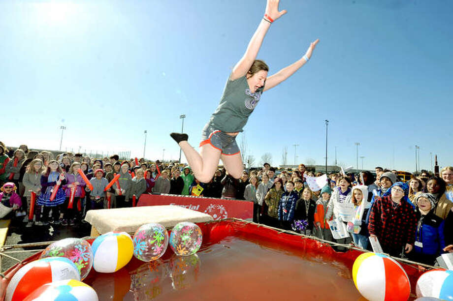 Kaitlyn Wuebbels of Breese jumps into a pool of very cold water during the polar plunge for Special Olympics Illinois Friday at the Chuck Fruit Aquatic Center. Photo: Thomas Turney | For The Intelligencer