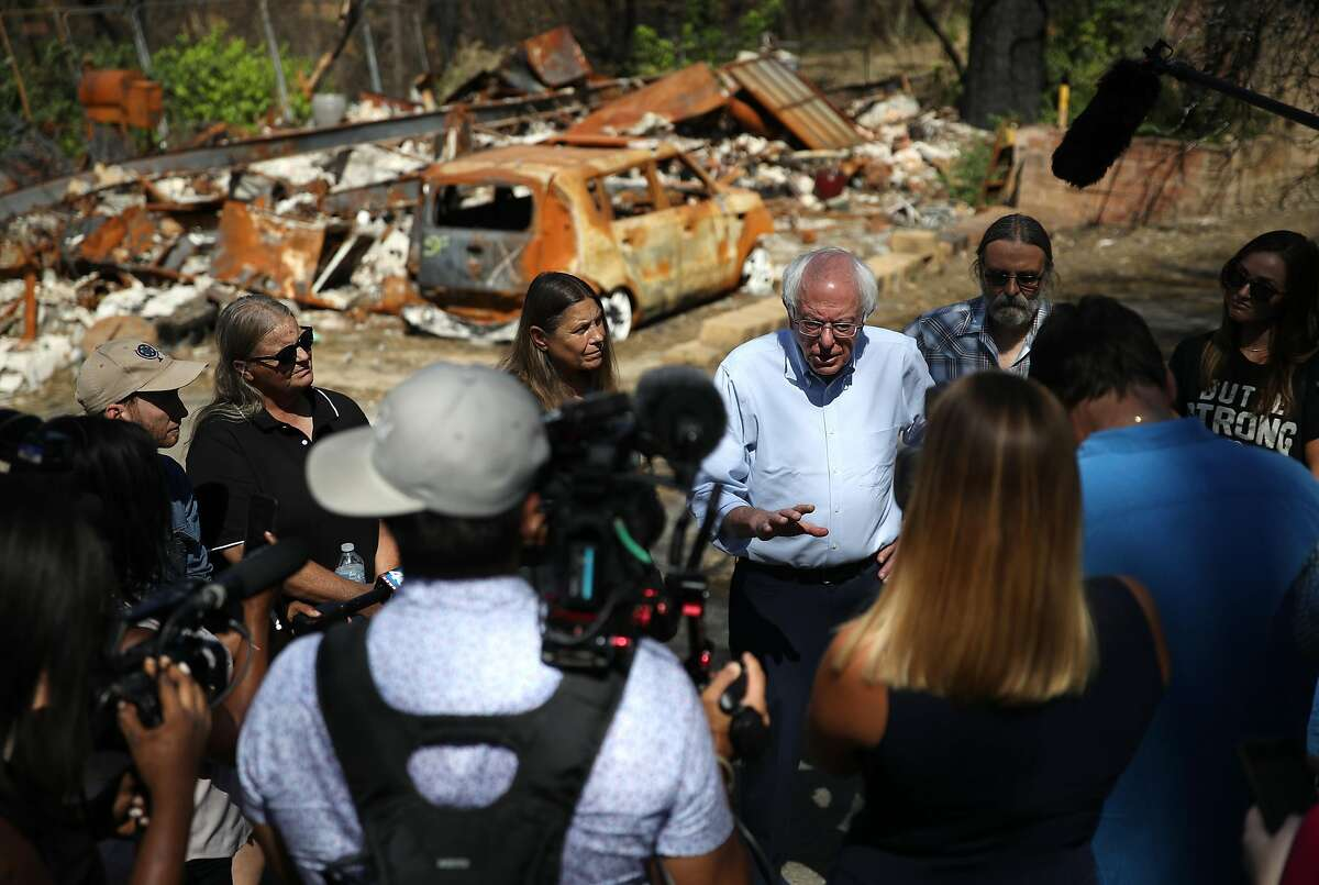 PARADISE, CALIFORNIA - AUGUST 22: Democratic presidential candidate U.S. Sen. Bernie Sanders (I-VT) talks with members of the media as he tours a mobile home park that was destroyed by the Camp Fire on August 22, 2019 in Paradise, California. Bernie Sanders is visiting the communities that were devastated by the Camp Fire last year. (Photo by Justin Sullivan/Getty Images) PARADISE, CALIFORNIA - AUGUST 22: Democratic presidential candidate U.S. Sen. Bernie Sanders (I-VT) talks with members of the media as he tours a mobile home park that was destroyed by the Camp Fire on August 22, 2019 in Paradise, California. Bernie Sanders is visiting the communities that were devastated by the Camp Fire last year. (Photo by Justin Sullivan/Getty Images)